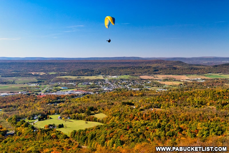 A paraglider sails over Tuscarora Summit near the Buchanan State Forest in Fulton County PA