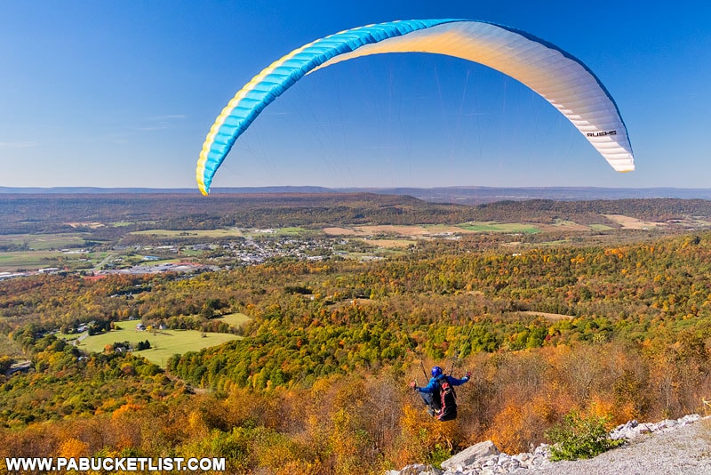 A paraglider launches from Tuscarora Summit along Route 30 in Fulton County PA
