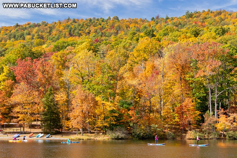 Kayakers and paddleboarders at Cowans Gap State Park.
