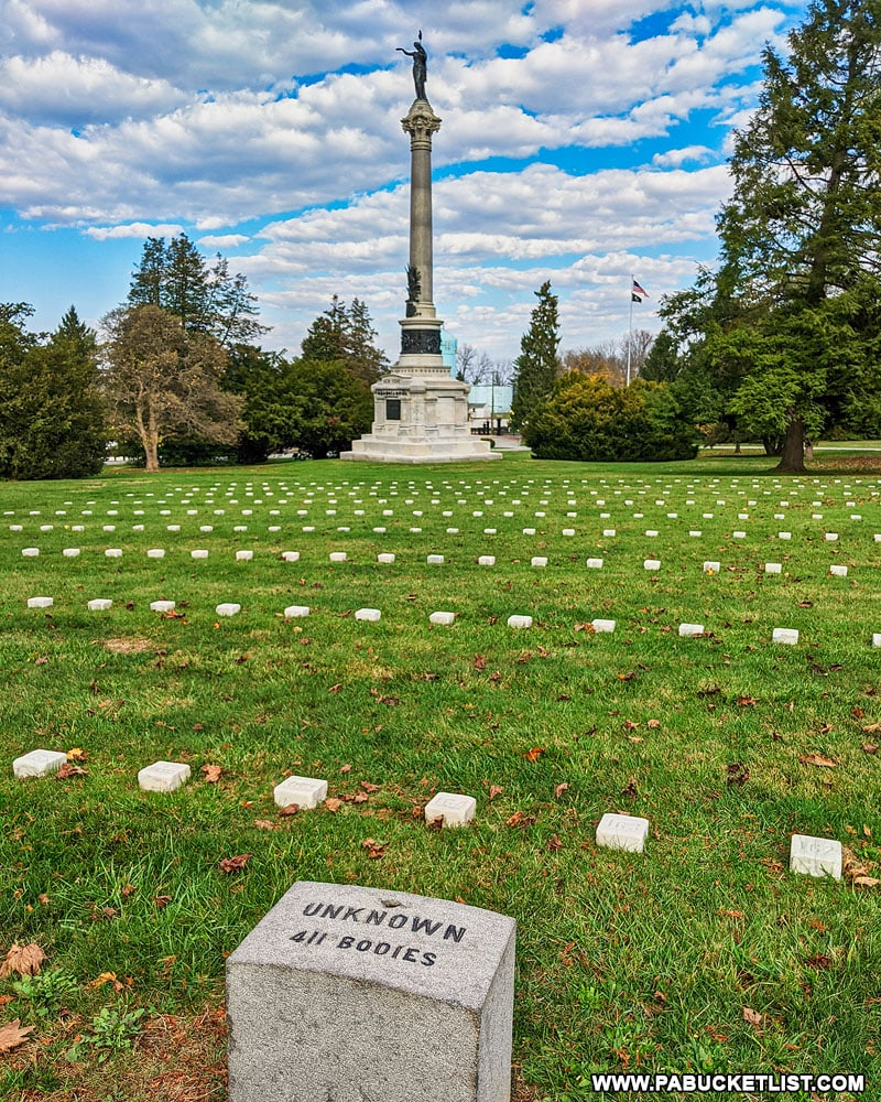 The graves of unknown Union soldiers with the New York Monument in the background.