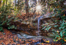 The sunsetting behind Hippie Shower Falls along the Great Allegheny Passage in Fayette County.