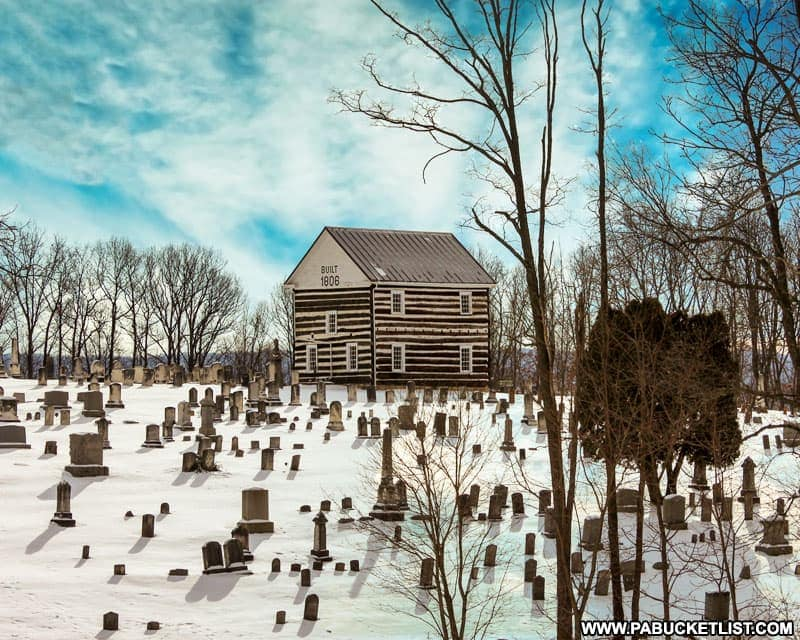 A winter scene at the 1806 Old Log Church in Bedford County, Pennsylvania.