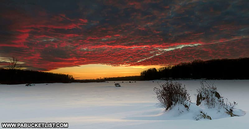A red sky winter sunset at Black Moshannon State Park.