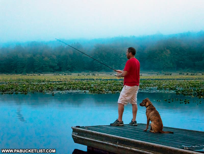 A fisherman and his dog at Black Moshannon State Park.