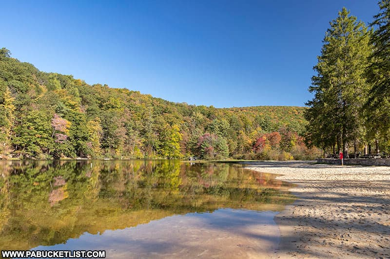 Fall foliage reflections near the beach at Greenwood Furnace State Park.