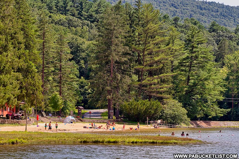Visitors enjoying the beach at Greenwood Furnace State Park.