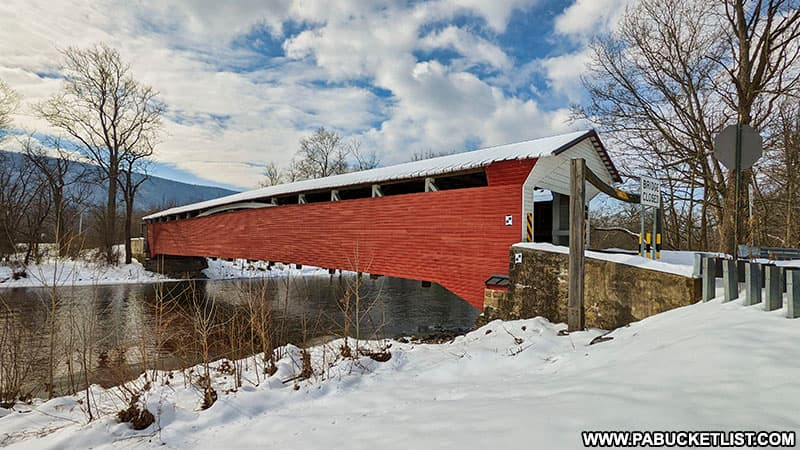 A side view of Millmont Covered Bridge over Penns Creek.