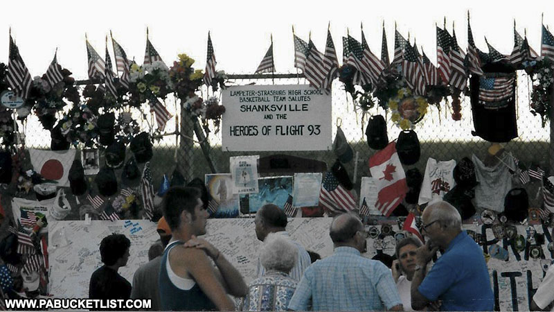 An early Flight 93 Memorial consisted of a 40 foot-long chain link fence where visitors left mementos and tributes.