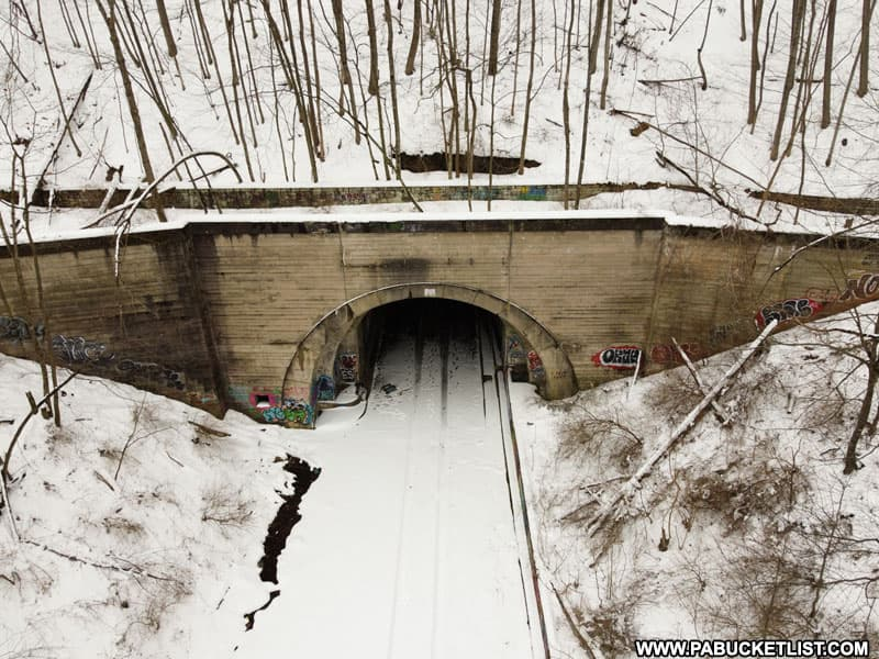 Aerial view of the eastern portal of Rays Hill Tunnel in the snow.