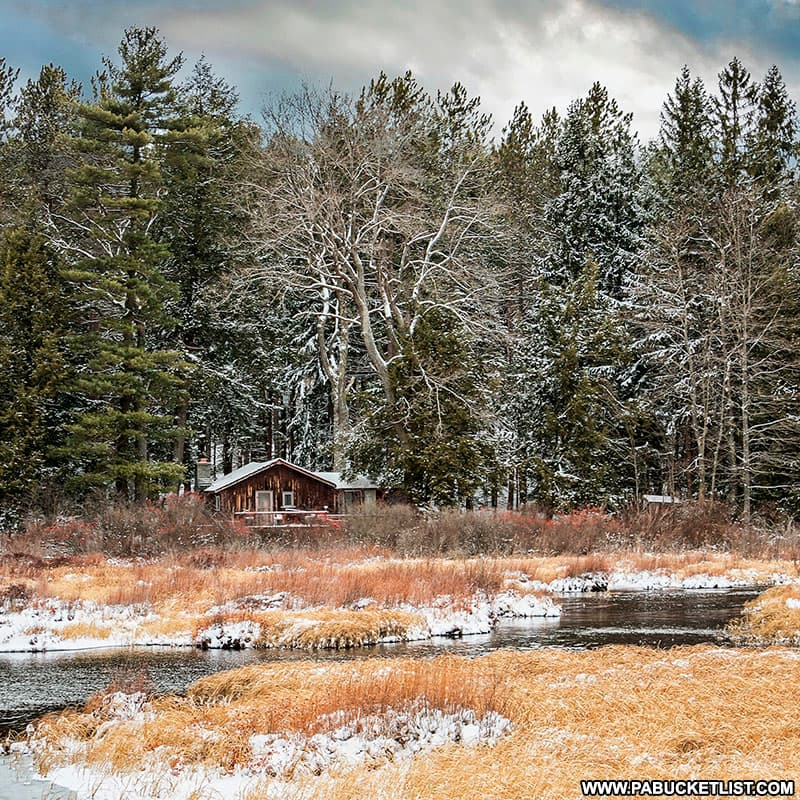 A winter view of a rustic cabin at Black Moshannon State Park.
