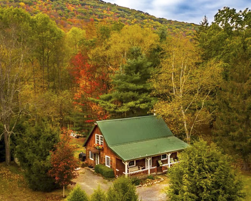 Exterior of log cottage vacation rental along Pine Creek in the PA Grand Canyon near Wellsboro PA