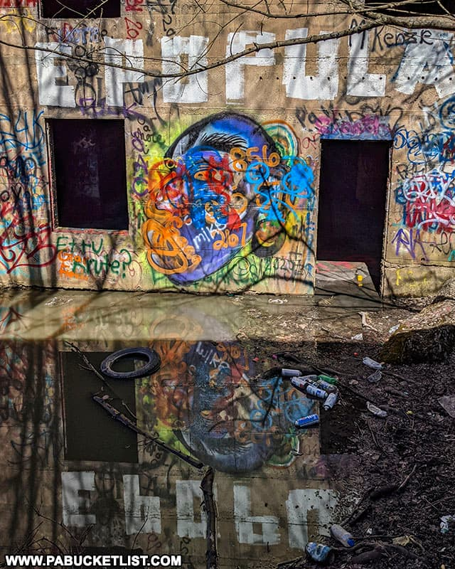 Graffiti reflected off a pool of water in Concrete City.