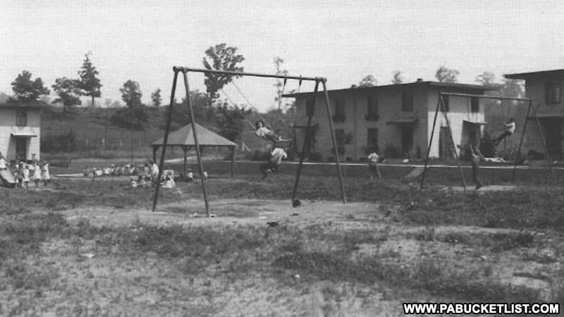 Children on the playground at Concrete City in the early 1900s (public domain photo).