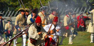 Historical reenactors staging an attack on Fort Ligonier.