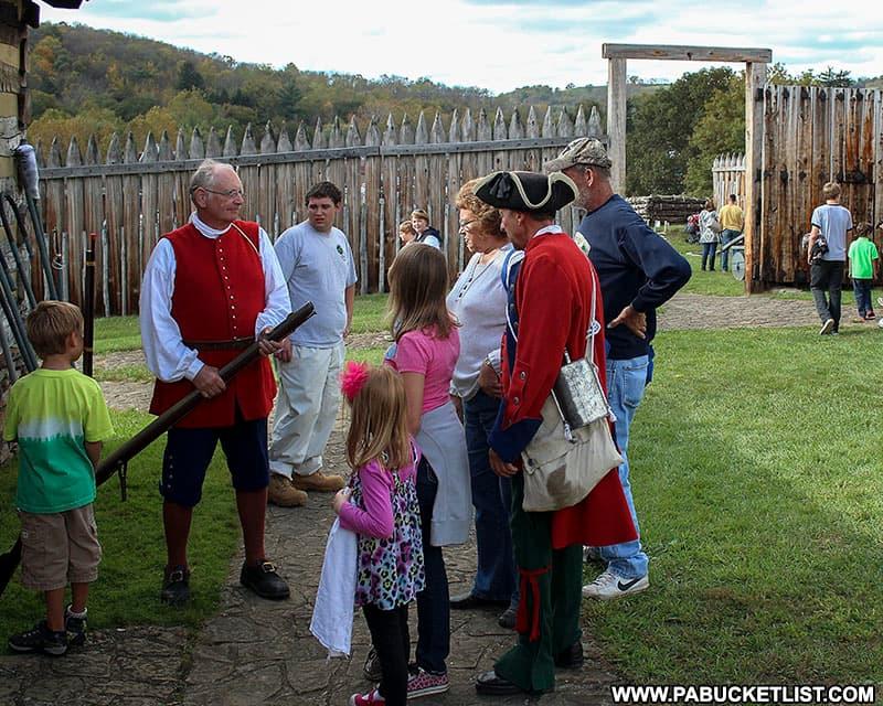 Interacting with historical reenactors at Fort Ligonier Days.
