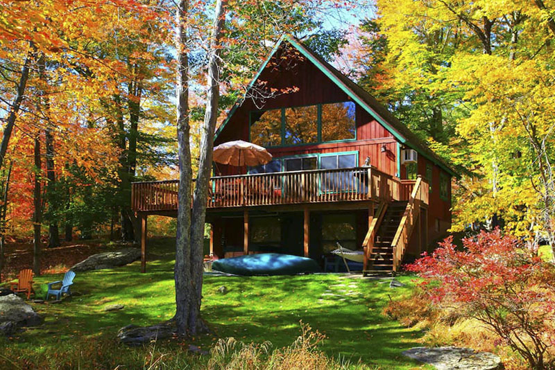 Exterior of an a-frame style vacation rental cabin in the Poconos.