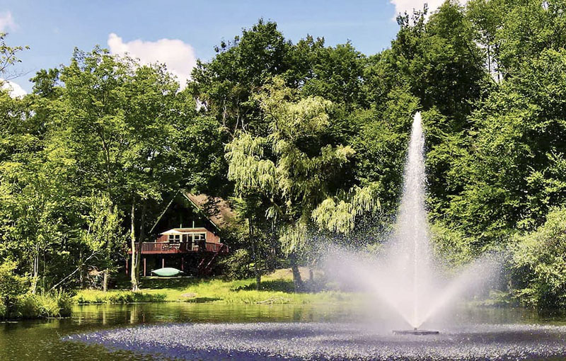 A vacation rental cabin featuring a fountain in the Poconos.