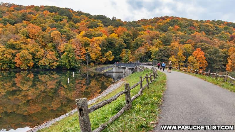 Fall foliage around the dam at Laurel Hill Lake.