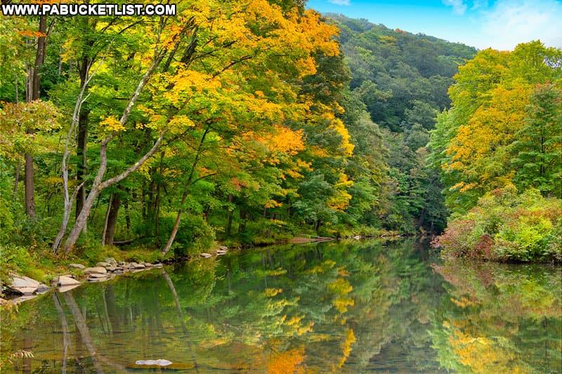 Fall foliage reflected on Laurel Hill Lake at Laurel Hill State Park.