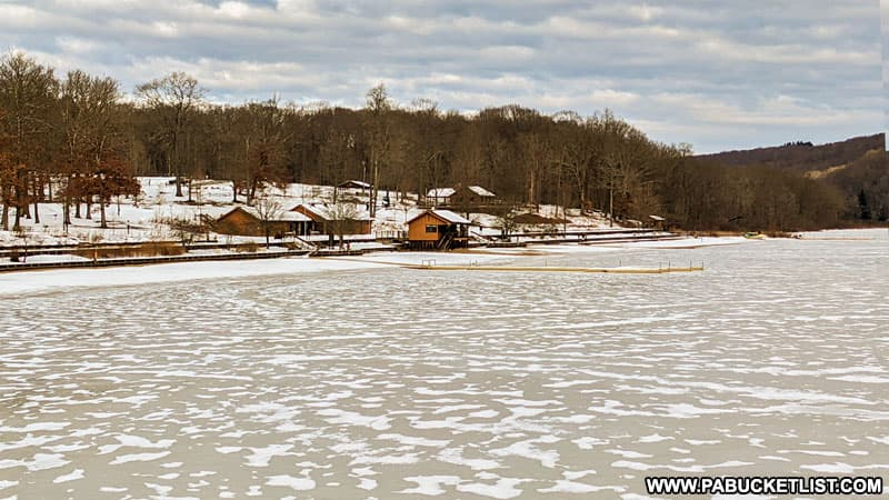 The frozen lake and beach at Laurel Hill State Park.