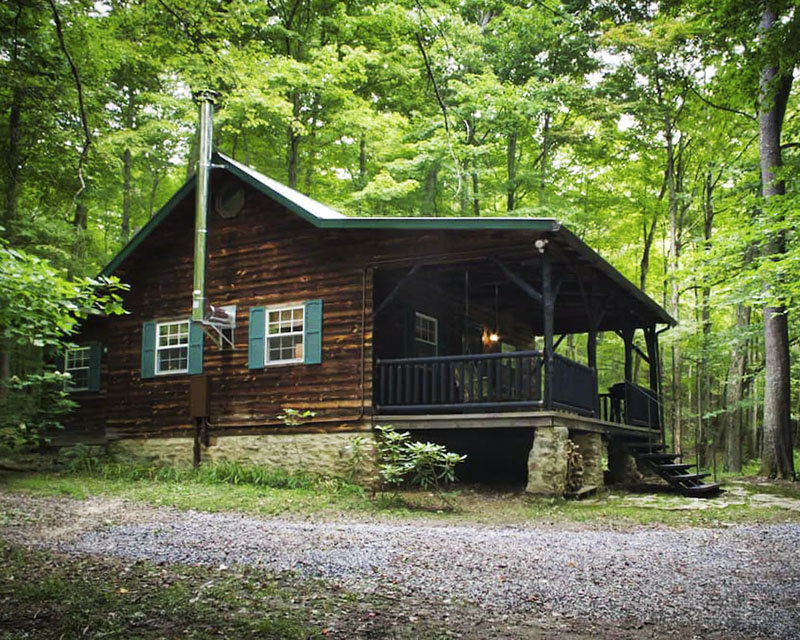 A rental cabin in a wooded setting in the Laurel Highlands.