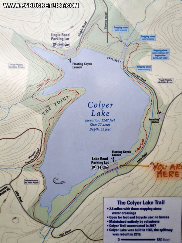A map of the Colyer Lake Trail posted near the Lake Road trail head.