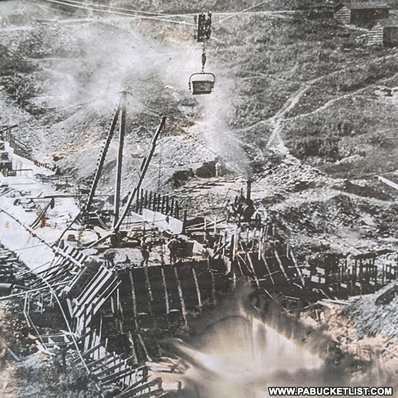 Photo of construction of the Austin Dam in 1909, on display at the Austin Dam Memorial Park.