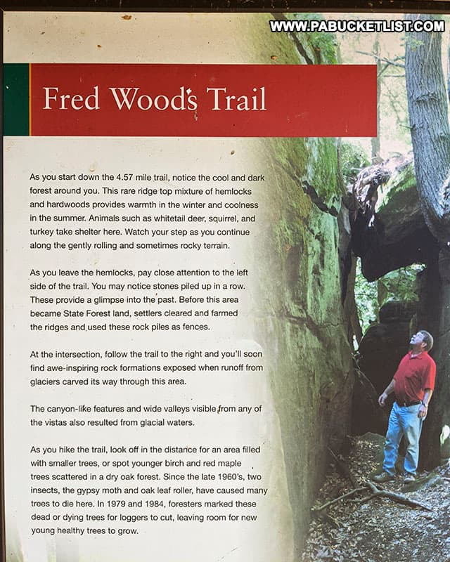 Informational sign about the Fred Woods Trail at the trail head.