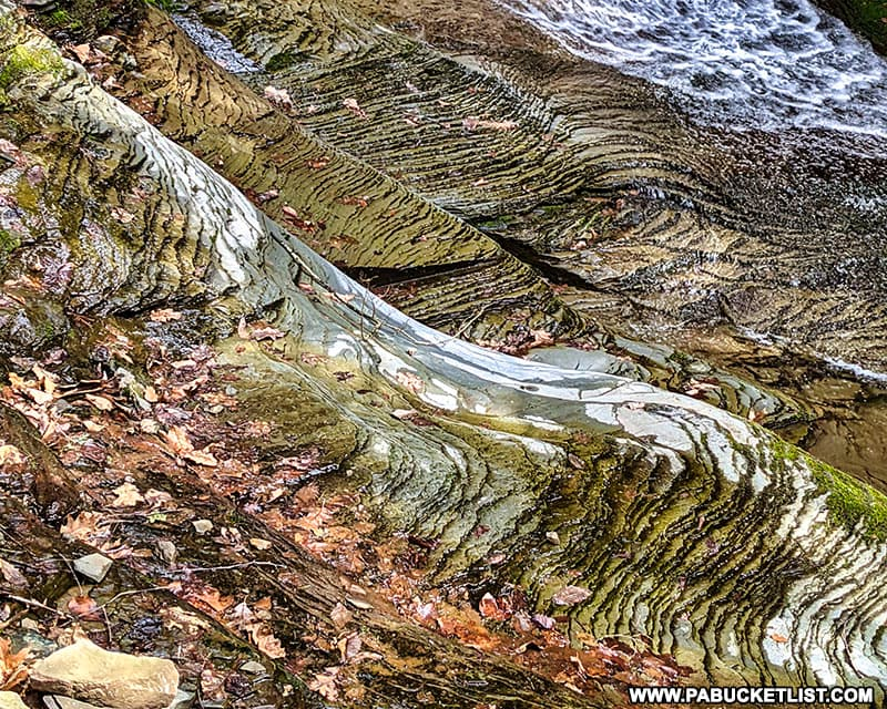 Rock formations around the upper tiers of Pine Island Run Falls in Tioga County.