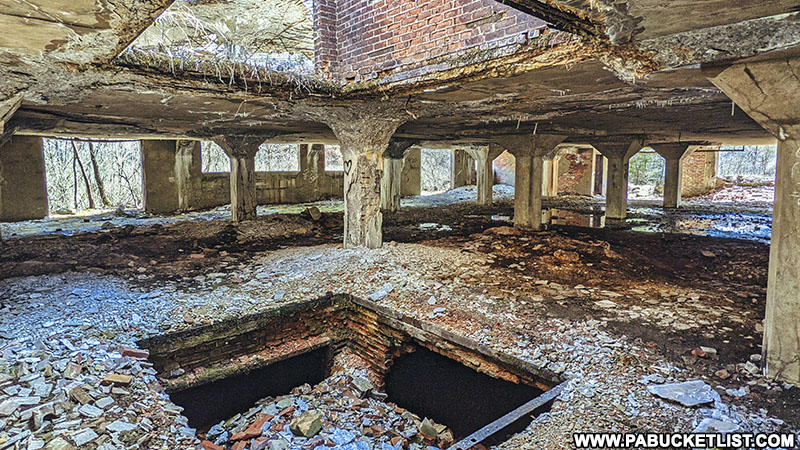 Holes in the floor and ceiling at the Bayless Paper Mill ruins in Potter County.