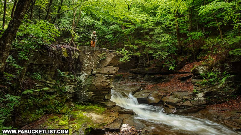 Large rocks and small waterfall along Little Schrader Creek in Bradford County Pennsylvania.