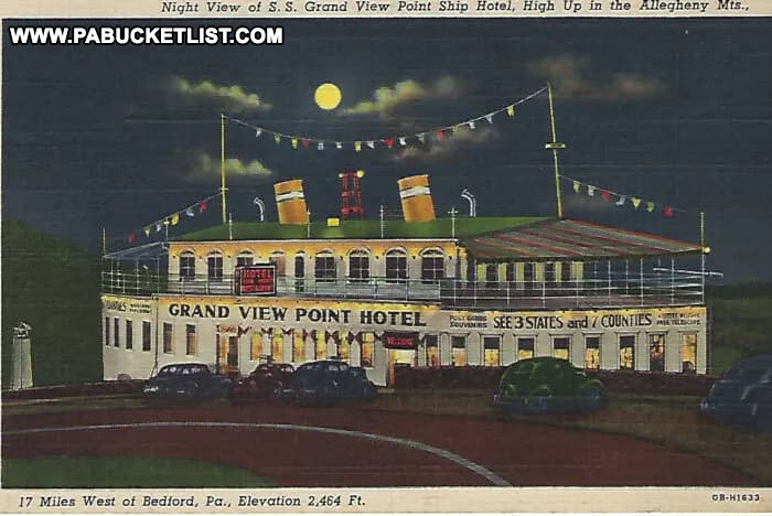 Postcard image of nightfall at the Grand View Ship Hotel along the Lincoln Highway.