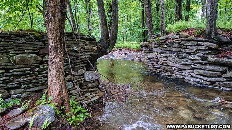 Remnants of a stacked-stone bridge abutment on Thomas Run on Bradford County.