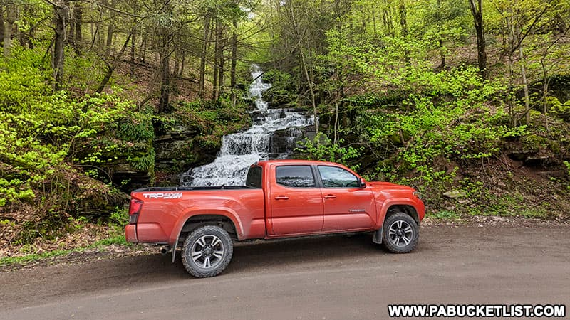 Toyota Tacoma parked in front of Holcomb Falls along Leroy Mountain Road in Bradford County PA
