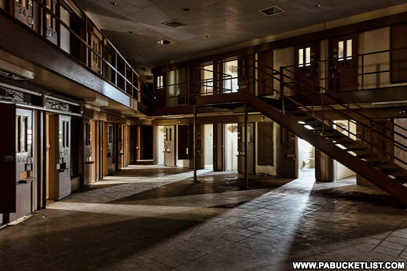 Natural light illumintaes a cell block at the abandoned Cresson State Prison in Cambria County.