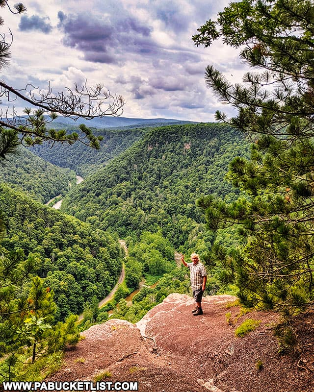 A hiker at Barbour Rock Overlook in the PA Grand Canyon.