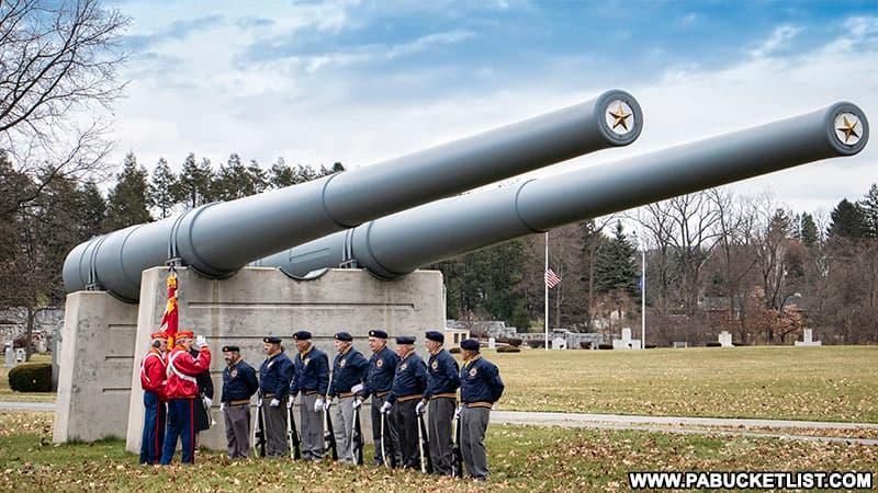 Pearl Harbor Day ceremony beneath the USS Pennsylvania guns.