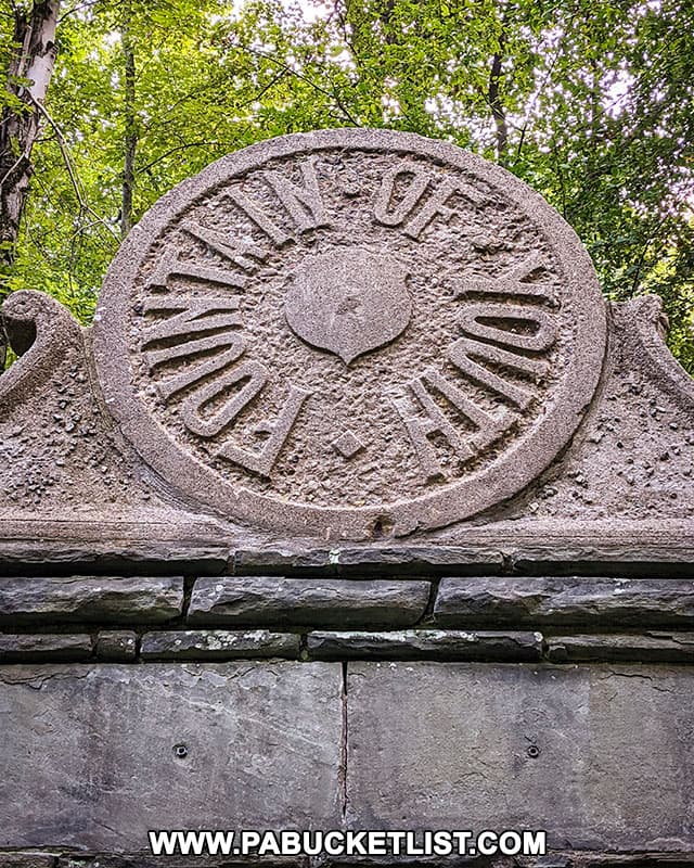 Close-up of the Fountain of Youth seal above the springhouse in North Park.
