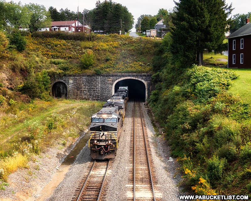 A westbound Norfolk-Southern train exiting the western portal of the Allegheny Tunnel in Gallitzin.