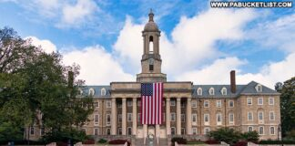 Old Glory hanging from the front of Old Main at Penn State.
