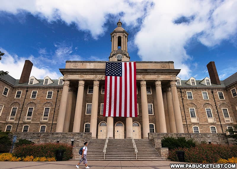 The American flag draped in front of the pillars of Old Main at Penn State in remembrance of the victims of 9/11/2001.