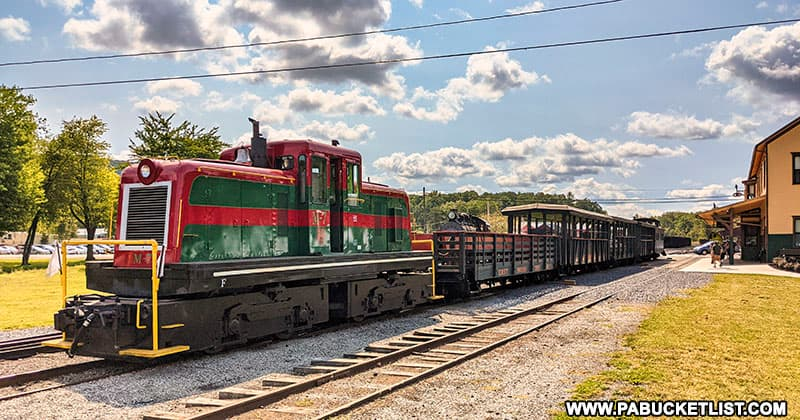 A diesel engine pulls passenger cars along the East Broad Top Railroad line in September, 2021.