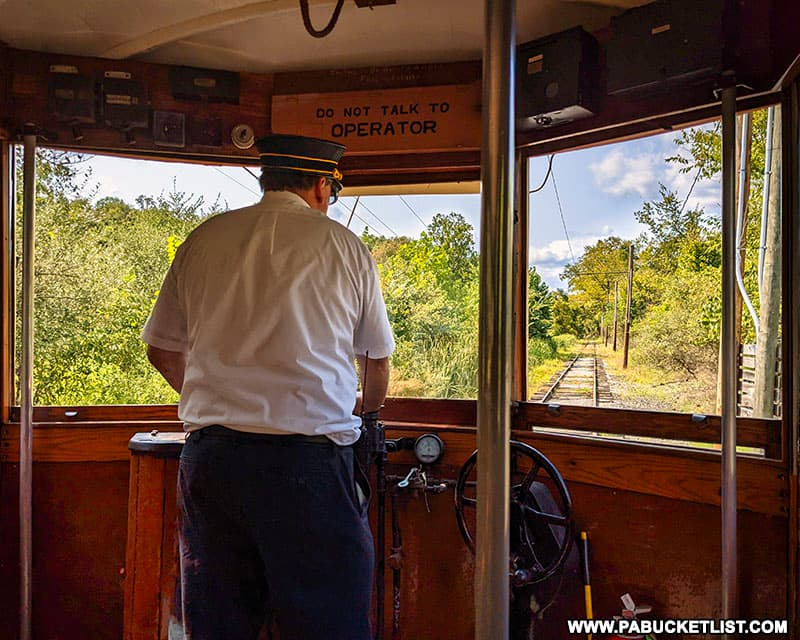 """The """"motorman"""" operating the electric trolley on an excursion along the Shade Gap branch of the East Broad Top Railway."""