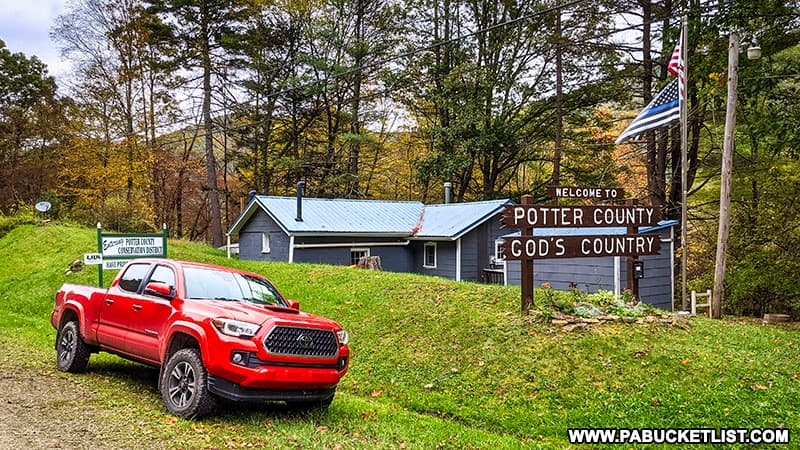 Welcome to God's Country sign at the Potter - Cameron county line near Sinnemahoning State Park.
